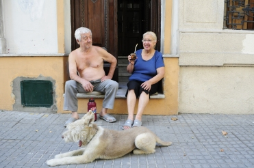 A Uruguyan couple enjoying their mate on the doorstep of their house.
