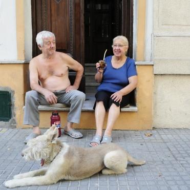 A Uruguyan couple enjoying their mate on the doorstep of their house.