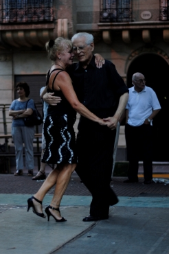 An elderly couple intensly enjoying their Tango on a Sunday afternoon in San Telmo, Buenos Aires.