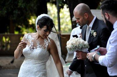A bride calming her nerves in Villa Borghese park, Rome.