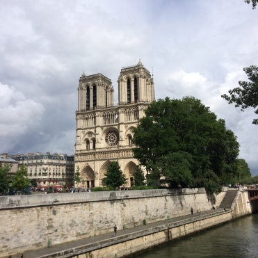 Notre Dame surrounded by clouds