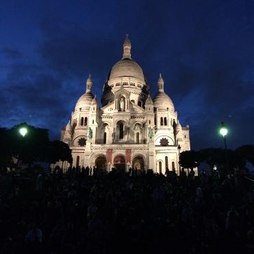 Beautifully lit Sacré-Cœur against deep blue skies