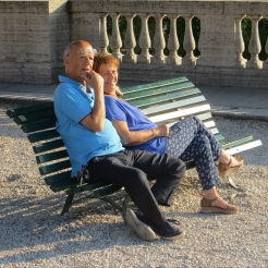 Pure relaxation - a couple enjoying people-watching in Villa Borghese park in the late afternoon.