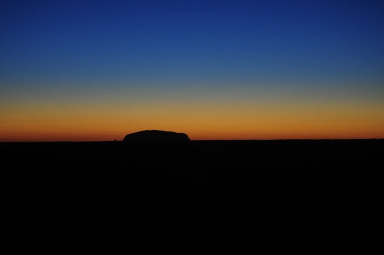 A mesmerising colour display as the sun rises behind Uluru.