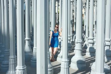 Posing with art installation Urban Light