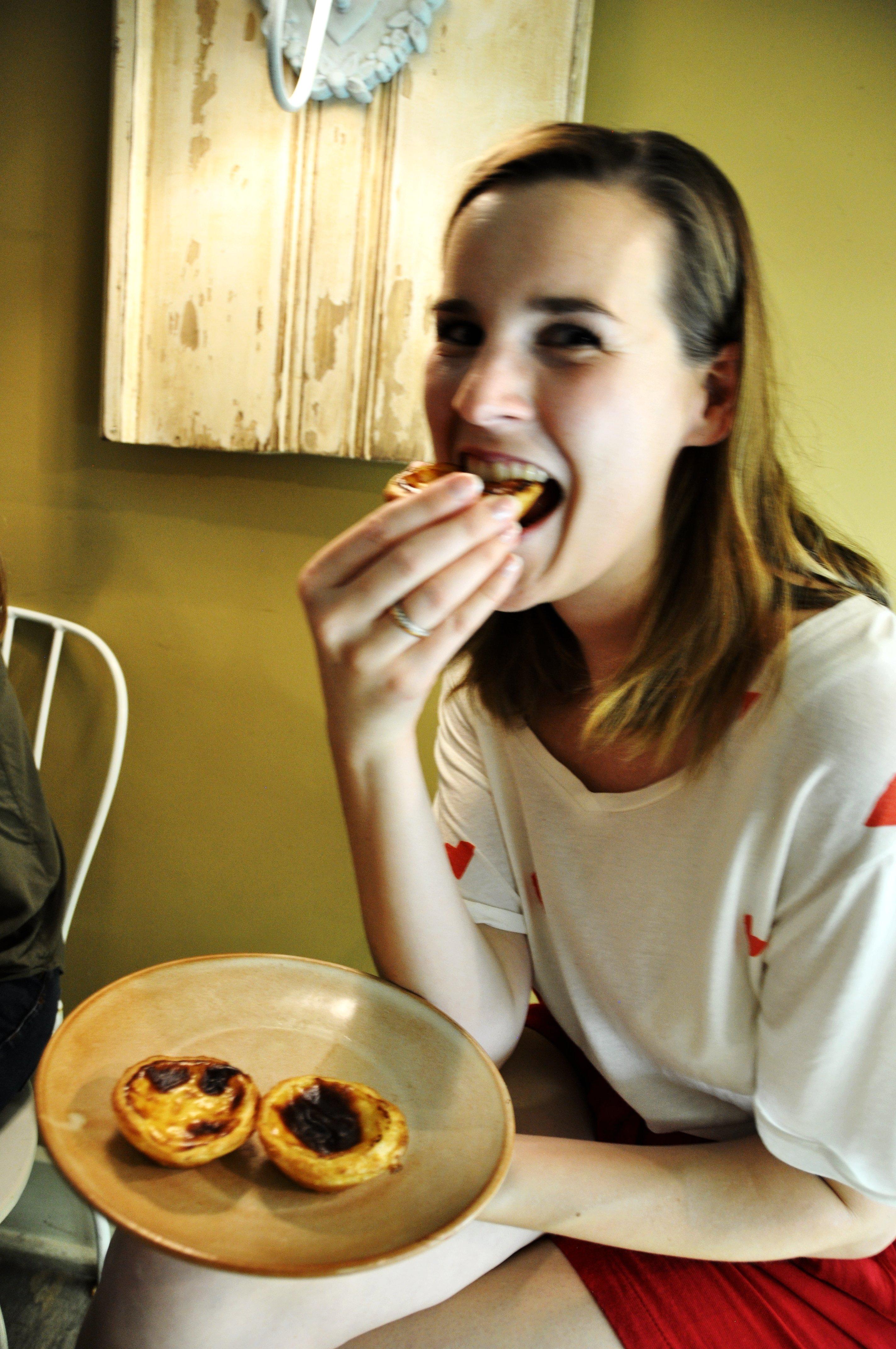 Sanne eating pastel de nata